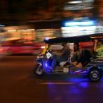 Tuk Tuk driving by in Bangkok Thailand